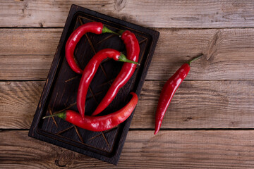 Red hot chili pepper on a wooden background