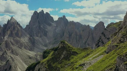Wall Mural - Extreme Scenic Mountain Trail in the Italian Dolomites and Hiker Walking Along the Edge. Aerial Footage.
