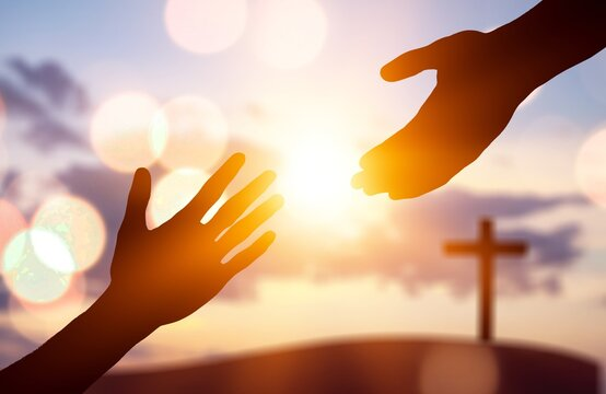 Silhouette of human hands helping to enother hands
