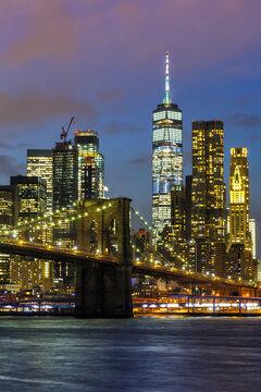 New York City skyline night Manhattan town Brooklyn Bridge World Trade Center portrait format