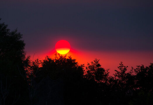 Sunset with multiple hues of red, orange, purple and yellow because of wildfires in Riverside county, California in September 2020