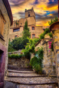 The village of Eus, a medieval commune in the Pyrenees-Orientales region, south of France, built on a hill, with a church at the top of the village