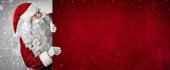 Photo sur Plexiglas Dinosaurs Santa Claus Showing Something On a Red Wall