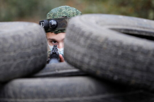 A member of a youth military patriotic club takes part in a tactical shooting game in Makeyevka