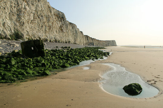 The beaches under the high white  cliffs on the shore of the Channel at Escalles in France with the ruins of the German bunkers from second world war.
