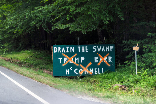 Roseland, USA - June 9, 2020: Nelson County, Virginia countryside with election roadside sign signpost board for drain the swamp with Trump, Barr and McConnell democratic in 2020