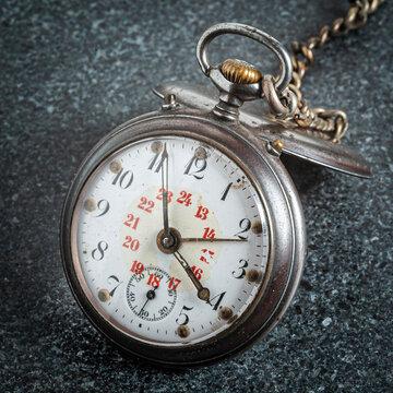 Vintage pocket watch on grey stone background 2