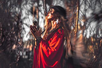 Obraz beautiful young woman with shamanic fire outdoors - fototapety do salonu