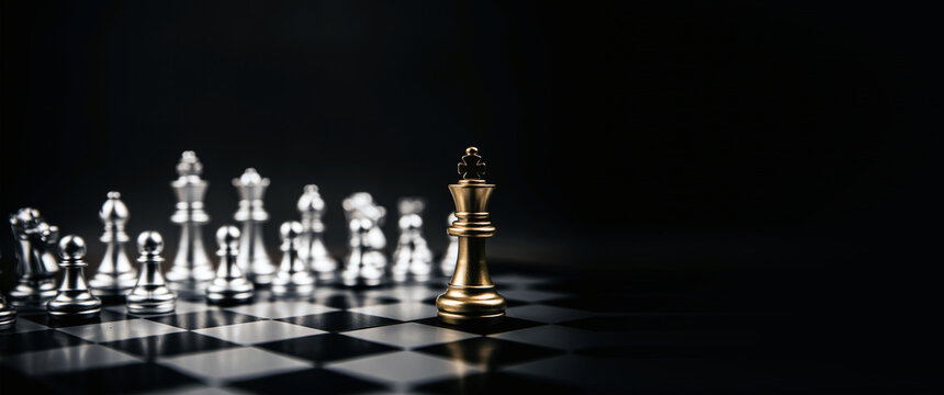 King golden chess standing confront of the silver chess team to challenge concepts of leadership and business strategy management and leadership
