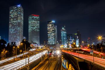 city skyline at night light trails
