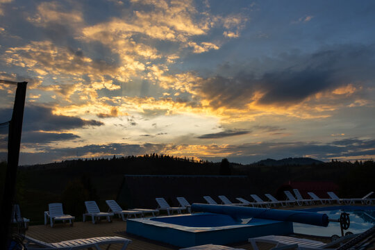 Swimming pool against the backdrop of a beautiful sunset.