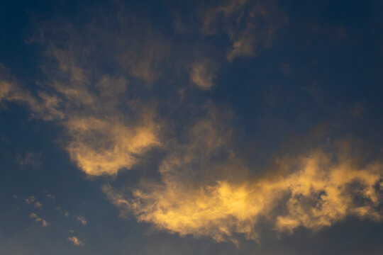 Beautiful cloud at sunset. Close-up. Backgrounds. Textures.