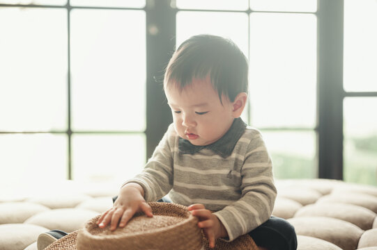 11 months baby boy portrait, asian kid face, little boy smiling