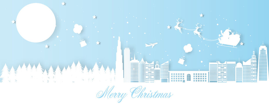 Christmas decoration greeting card with santa claus riding sledge in city.
