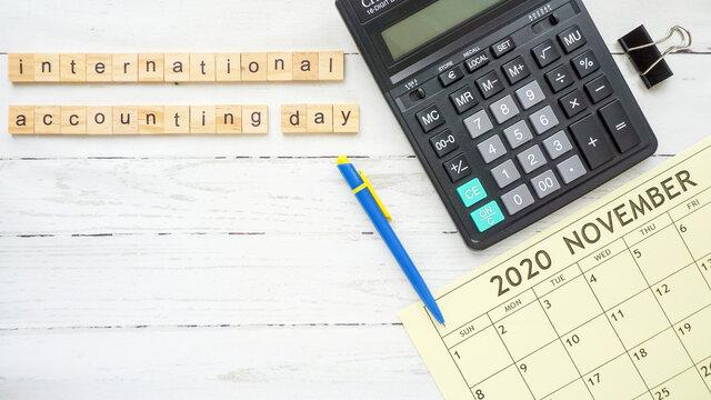 international accounting day. calculator and calendar photo