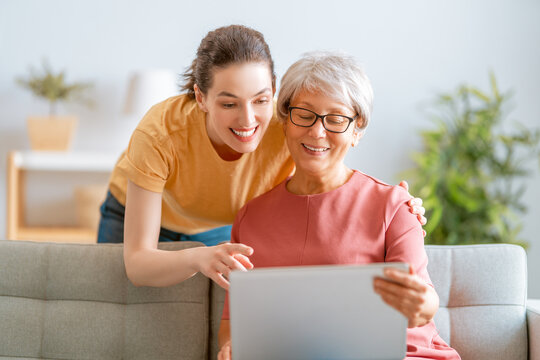 Young and senior women are using laptop