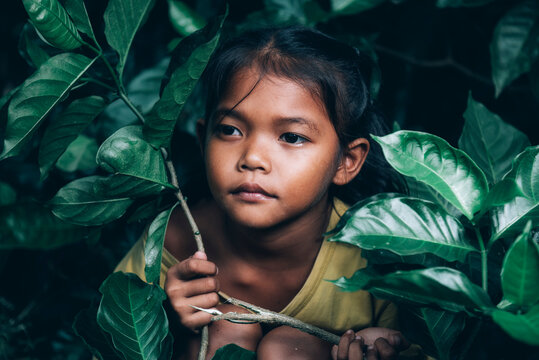 An 8-year-old Thai poor girl is lovely in a homeless neighborhood.