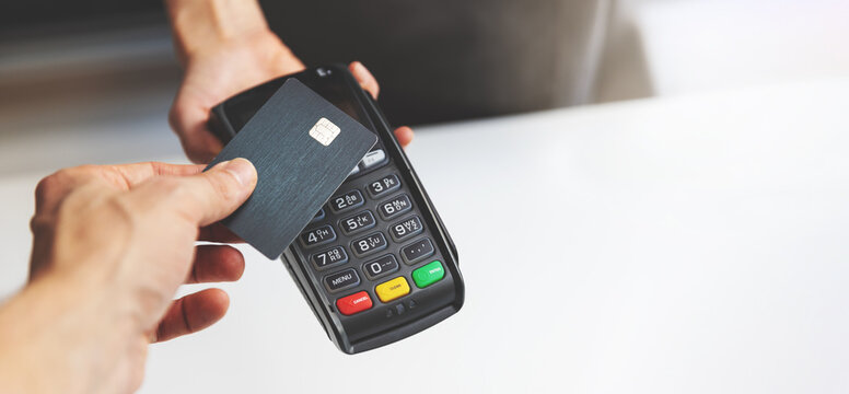 nfc contactless payment by credit card and pos terminal. copy space