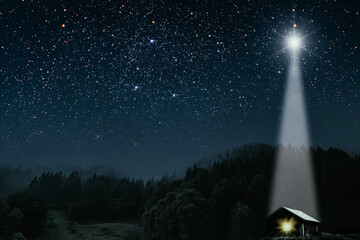 The star shines over the manger of christmas of Jesus Christ