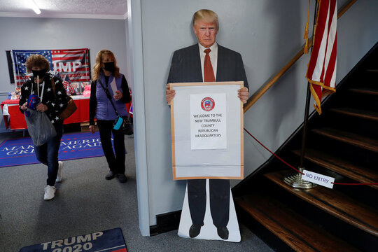 People shop for political souvenirs at the Trumbull County Republican Party headquarters in Warren, Ohio
