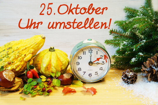 German: October 25, change clock, autumn decoration with clock