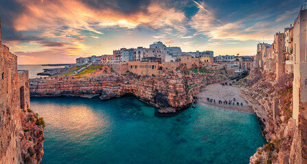 Spectacular spring cityscape of Polignano a Mare town, Puglia region, Italy, Europe. Incredible evening seascape of Adriatic sea. Traveling concept  background.