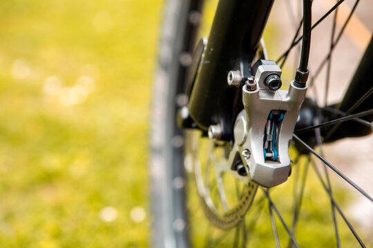 Close-up of a mountain bike brake system. See worn brake disc and hydraulic brake mechanism. Copy space