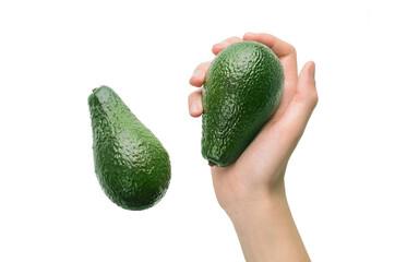 Avocado fruit and avocado in hand - raw healthy natural organic food