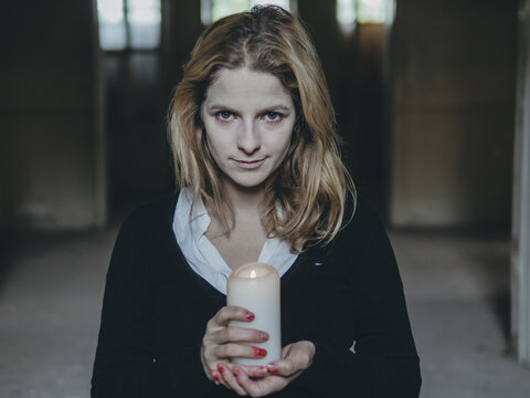 Creepy woman holding candle at halloween