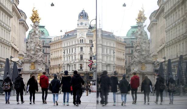 People walk past Graben shopping street in Vienna