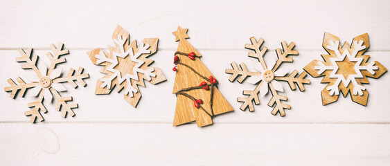 Wall Mural - Top view of Christmas decorations and toys on wooden background. New Year holiday concept with empty space for your design