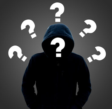 A white question mark surrounds a mysterious person wearing a hooded sweater: the concept of self-doubt, work and search for people.