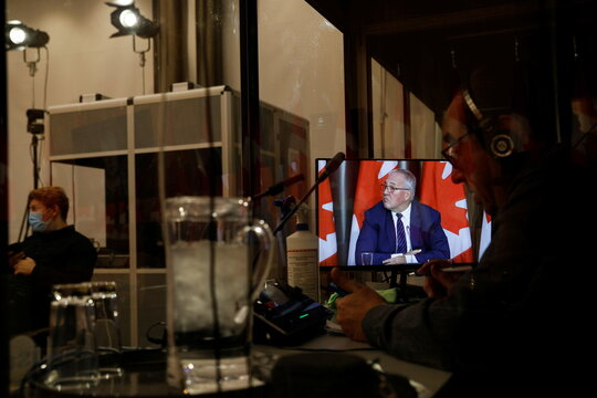 Canada's Minister of Public Safety and Emergency Preparedness Bill Blair (on a screen) takes part in a news conference about the dispute between commercial and Mi'kmaw lobster fishers in Nova Scotia, on Parliament Hill in Ottawa