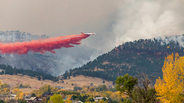Air tankers drop firefighting retardant on the Cal Wood Fire northwest of Boulder, Colorado.