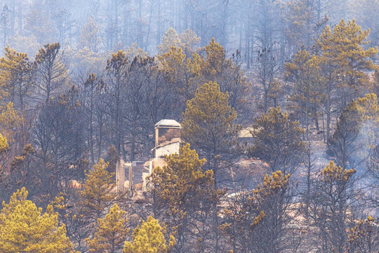 Homes and property are burnt to the ground and destroyed after the Cal Wood Fire raged through neighborhoods northwest of Boulder, Colorado