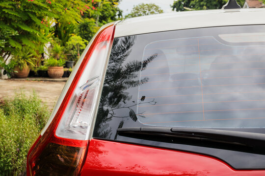 Back view of red car window for sticker mockup