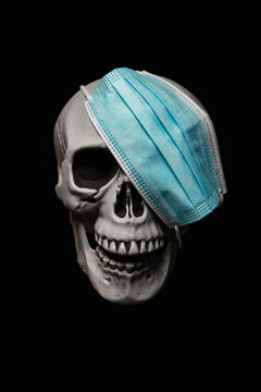 Human Skull with Surgical Mask as an Eye Patch