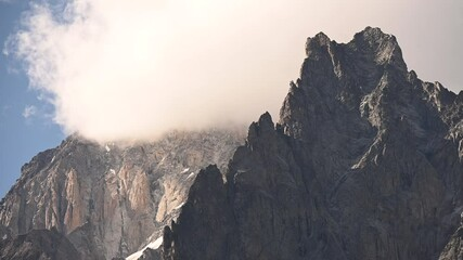 Wall Mural - Granite Peaks of the Mont Blanc Massif in Northern Italy Covered by Clouds