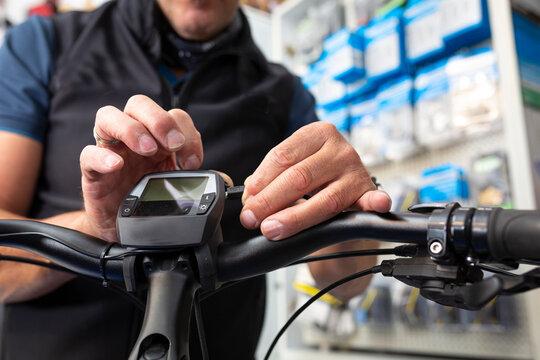 Bike mechanic maintains an e-bike
