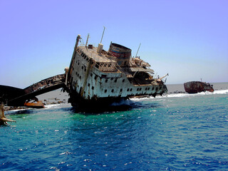 Shipwreck - remains of a ship stranded on a coral island in the sea