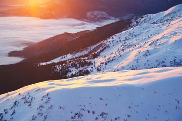 Wall Mural - Sun rays illuminate the mountain valley.