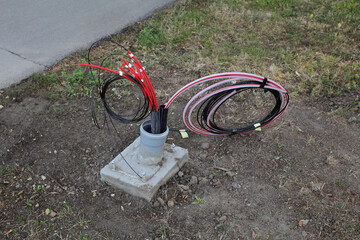 Optic fiber cables for internet and telephone installation, power lines installation at street
