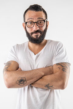 Man grimacing emotional faces Bearded tattoo man making facial expressions