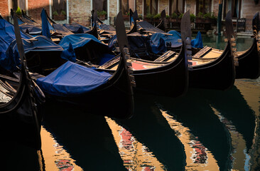 Venice, gondola view on a golden sunset