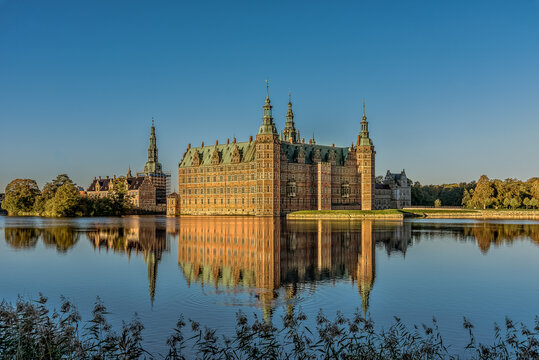 Frederiksborg Castle in a mirror-gloss reflection at surise
