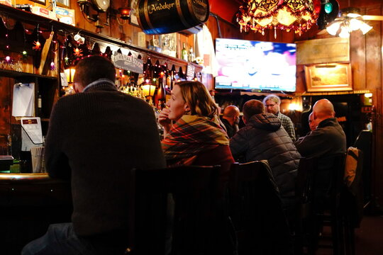 People drink and socialize inside the Swingin Door Exchange, as the coronavirus disease (COVID-19) outbreak continues in Milwaukee