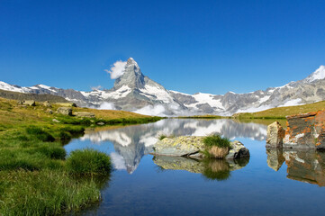 Beautiful Swiss Alps landscape with Stellisee lake and Matterhorn mountain reflection in water, summer mountains view, Zermatt, Switzerland
