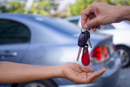 Sales agencies are selling cars and giving keys to new owners. sell car or rental car