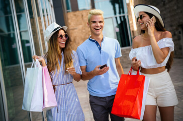 Friends having fun in the city shopping tourism enjoying together