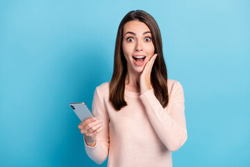 Portrait of her she nice attractive pretty cheerful cheery amazed brown-haired girl using device...